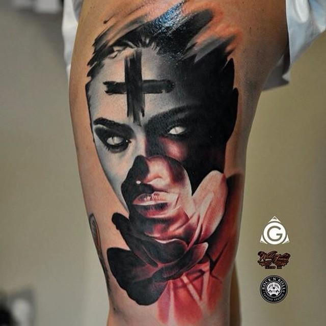 Modern traditional style colored thigh tattoo of demonic woman with black cross