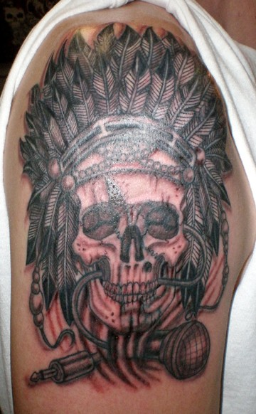 Music themed big black and white Indian skull with microphone tattoo on shoulder