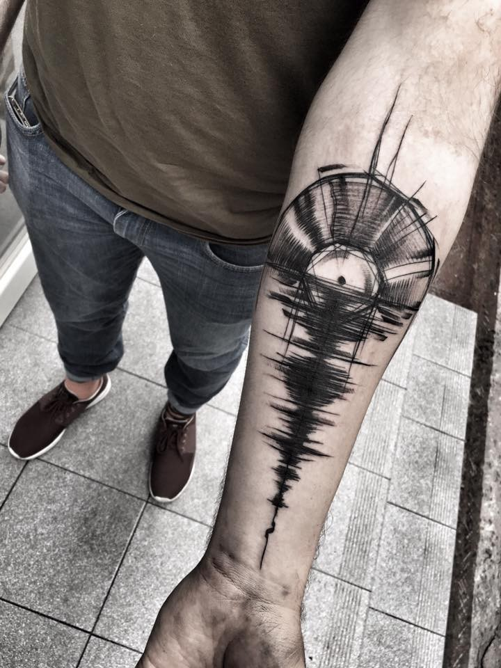 Music themed painted by Inez Janiak forearm tattoo of disk with shadow on water