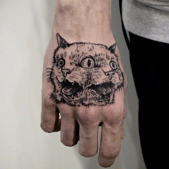 Mystical dot style hand tattoo of creepy cat with tree eyes