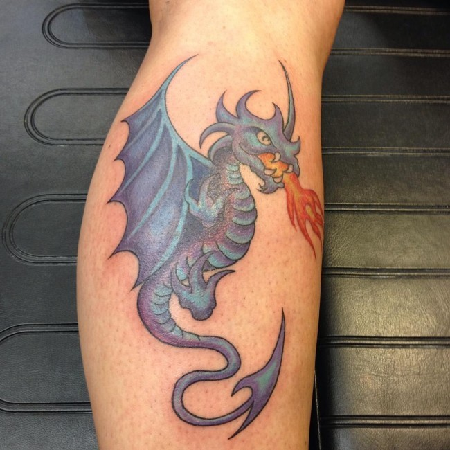 Mystical fairy tale fire-spitting dragon colored leg tattoo