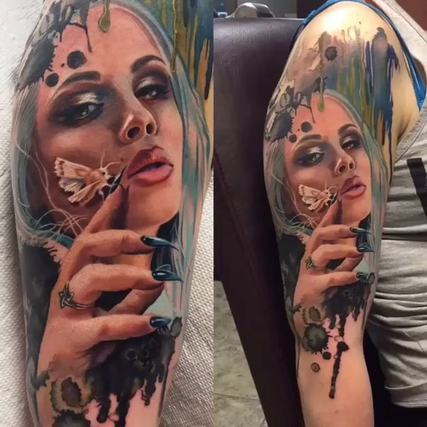 Natural looking colored shoulder tattoo of woman with butterfly
