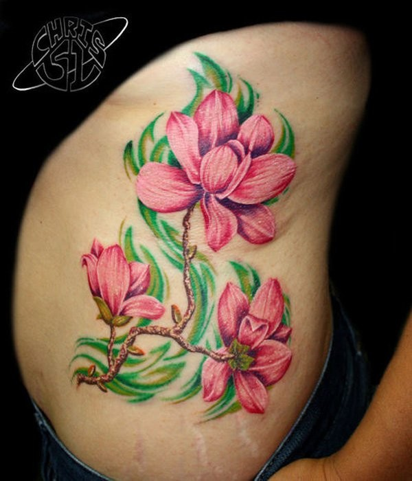 Natural looking colored side tattoo of big flower branch