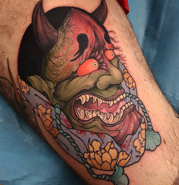 Neo japanese style accurate looking tattoo of demon face with flowers