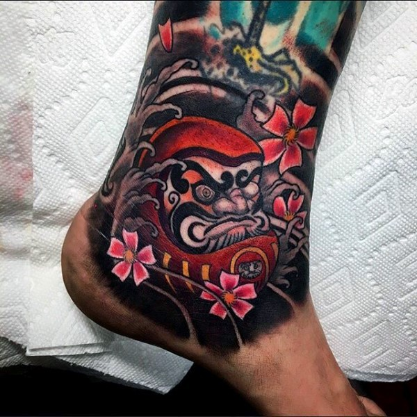 Neo japanese style colored  ankle tattoo of daruma doll with flowers