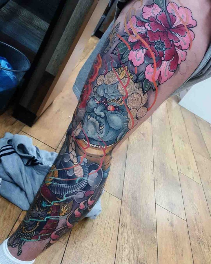 Neo japanese style colored whole leg tattoo of demon with various flowers