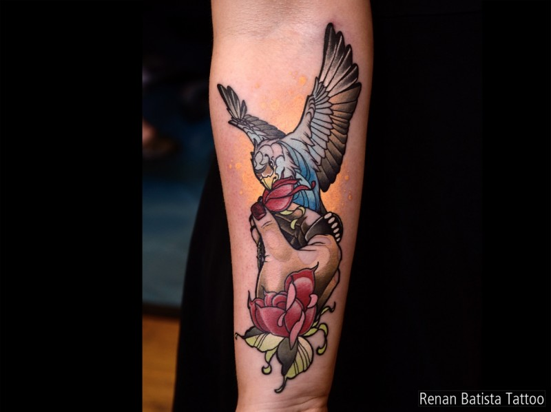 Neo traditional style colored forearm tattoo of small owl with woman hand and rose