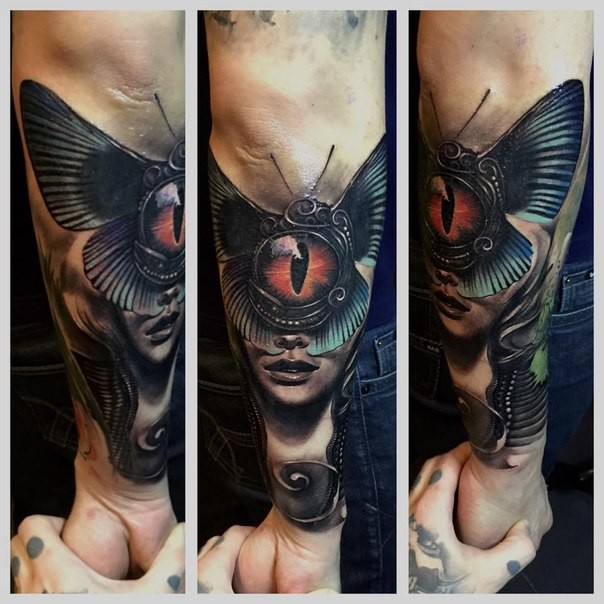 New school style colored arm tattoo of woman face stylized with butterfly and dragon eye