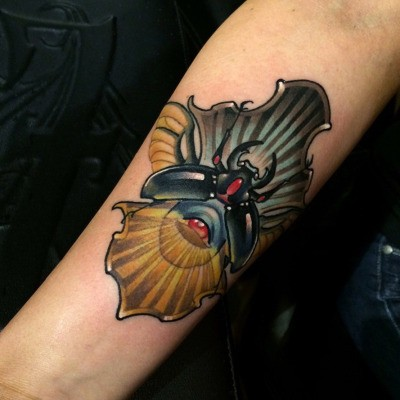 New school style colored arm tattoo of fantasy bug