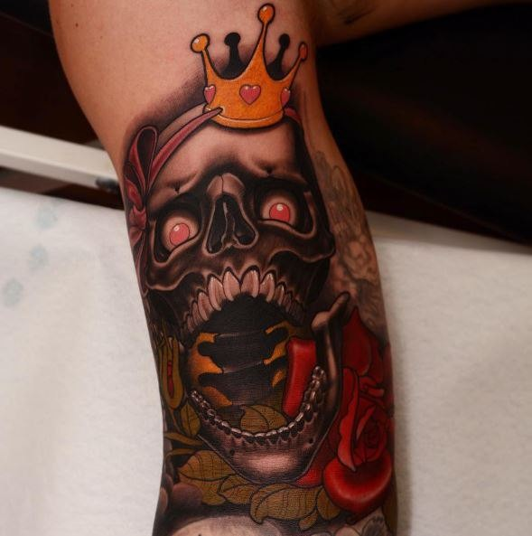 New school style colored arm tattoo of scary human skull with crown and roses
