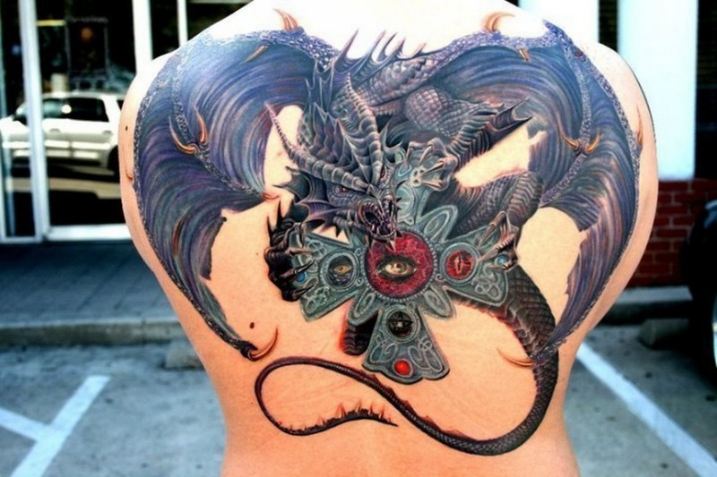 New school style colored back tattoo of fantasy dragon with iron cross