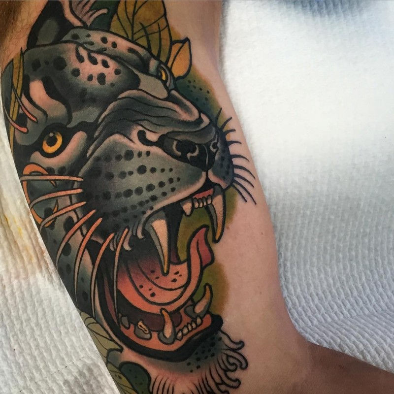 New school style colored biceps tattoo of cool leopard