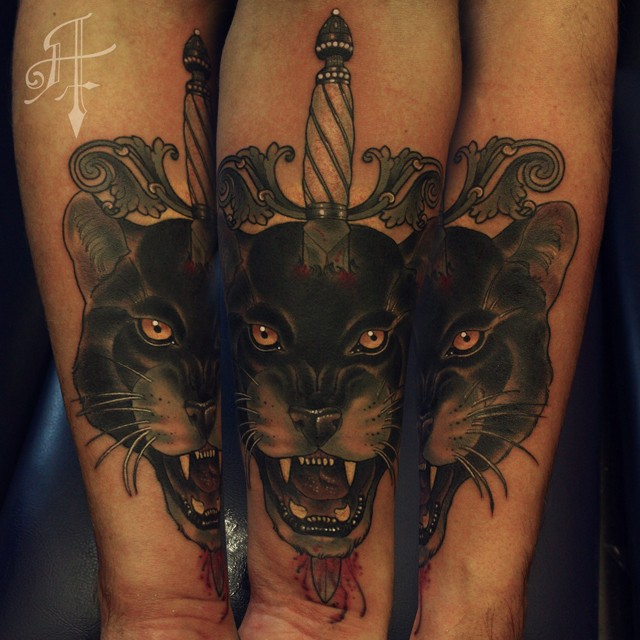 New school style colored forearm tattoo of black panther with dagger