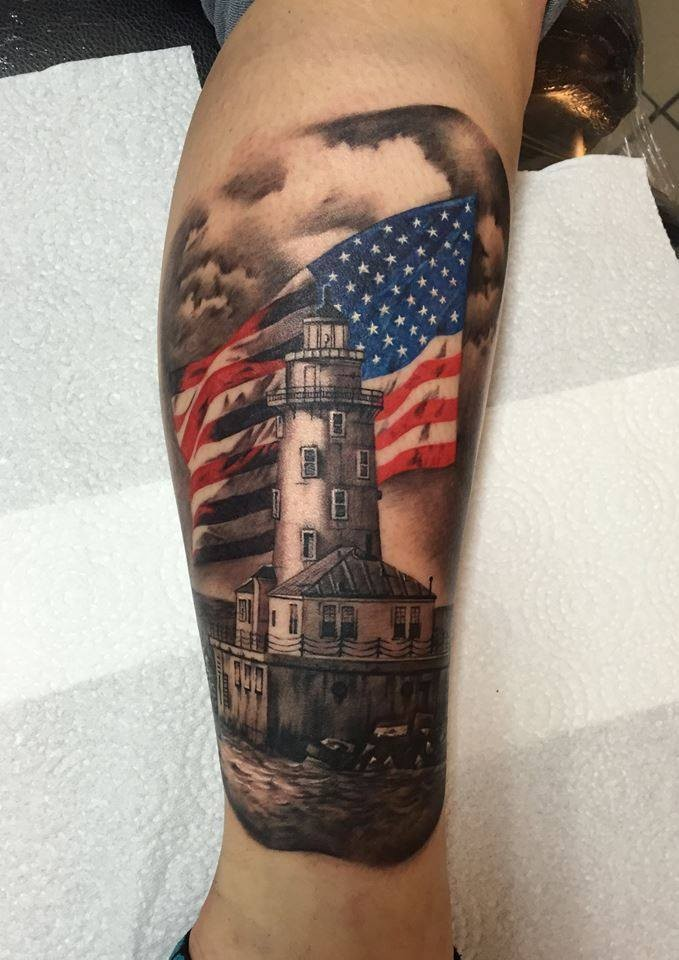 New school style colored leg tattoo of big lighthouse and flag