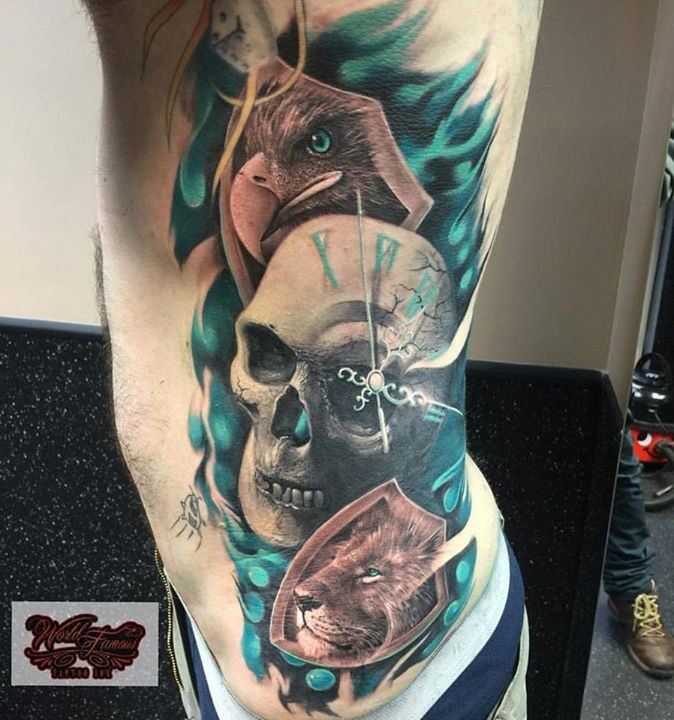 New school style colored side tattoo of human skull with eagle and lion