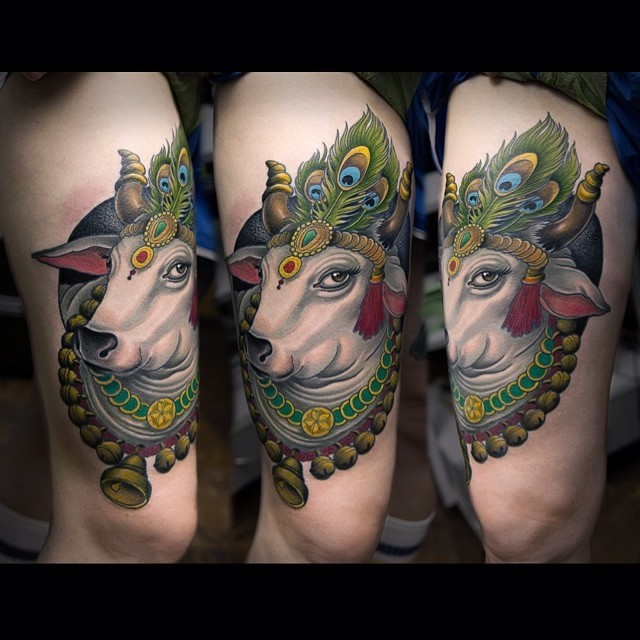 New school style colored thigh tattoo of big cow with feather
