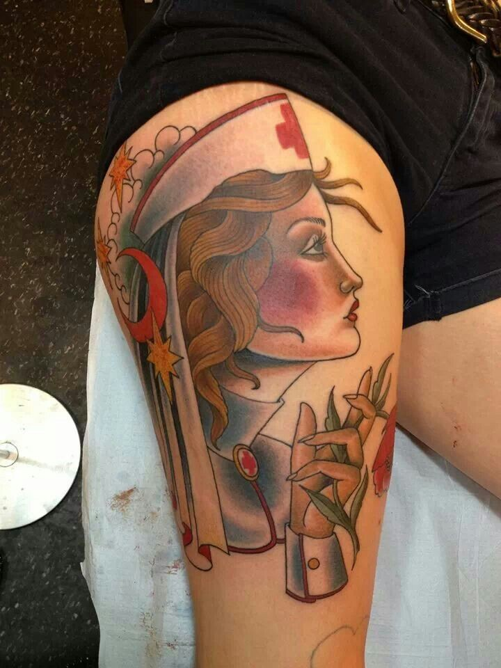 New school style colored thigh tattoo of seductive nurse with moon and stars