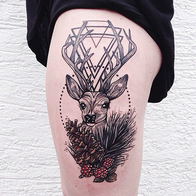 New school style colored thigh tattoo of deer combined with berries and triangles