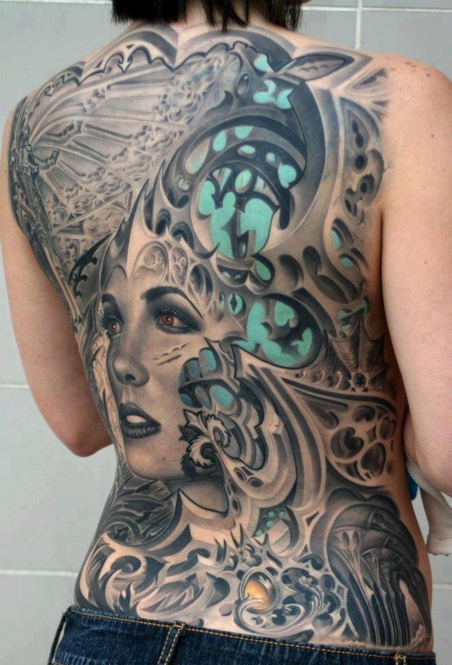 New style girl face with abstract patterns tattoo on whole back