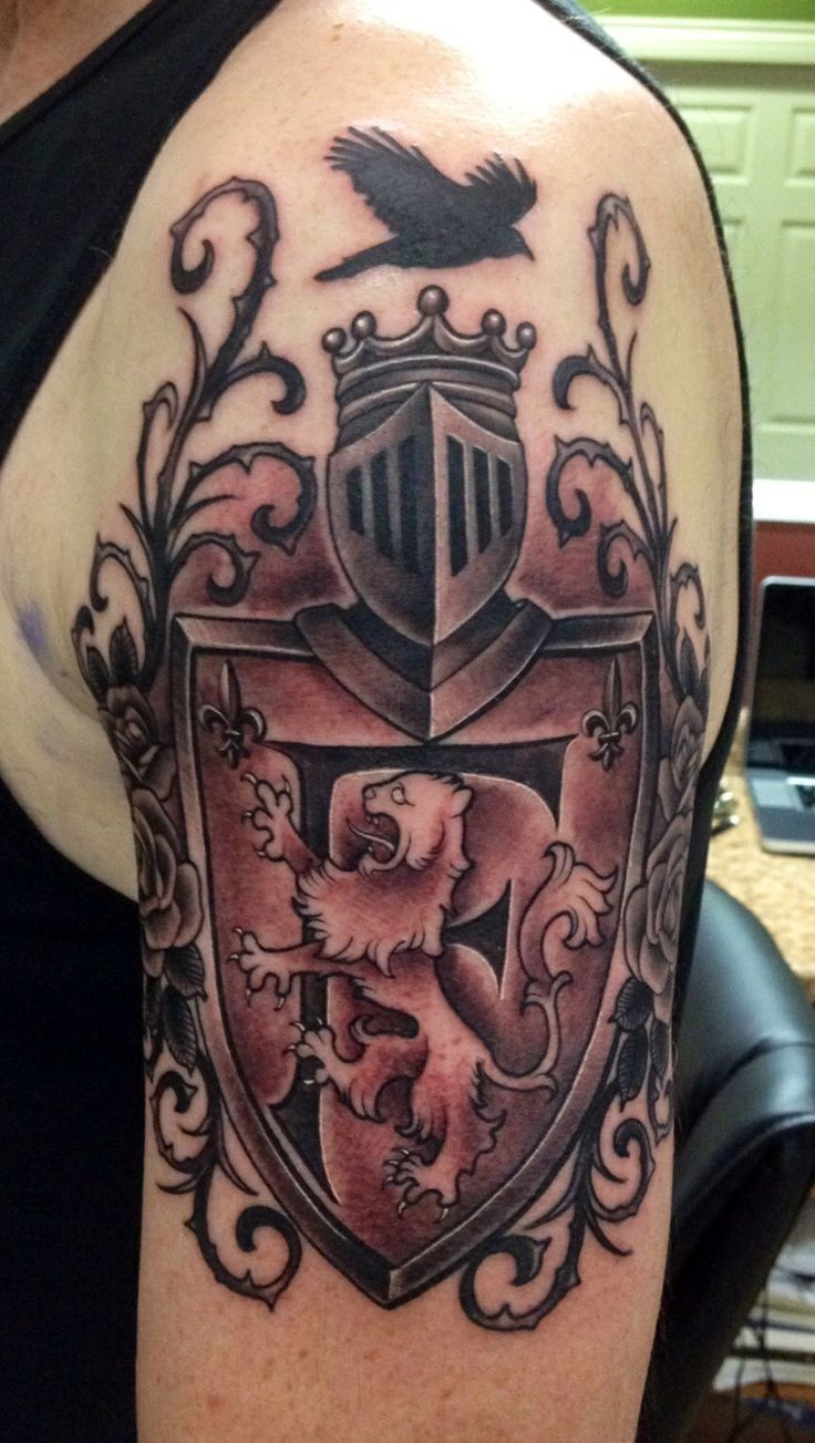 Nice black and white England native family crest tattoo on shoulder