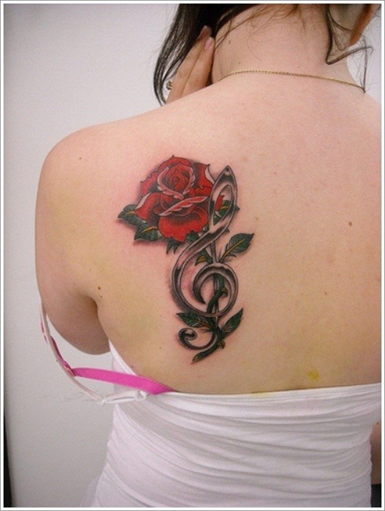 Nice combined big red rose with music note tattoo on shoulder