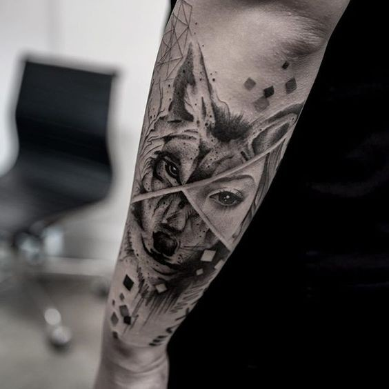 Nice combined black ink arm tattoo of wolf face with woman eye