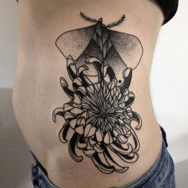 Nice combined blackwork style painted by Michele Zingales side tattoo of chrysanthemum flower and butterfly