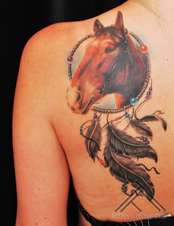 Nice looking colored scapular tattoo of dream catcher stylized with horse head