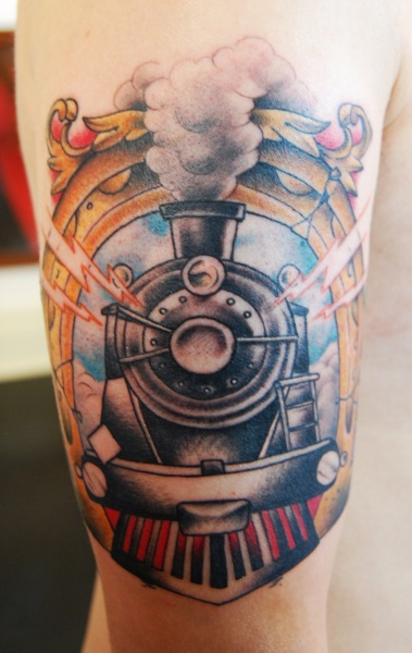 Old school colored upper arm tattoo of ancient train