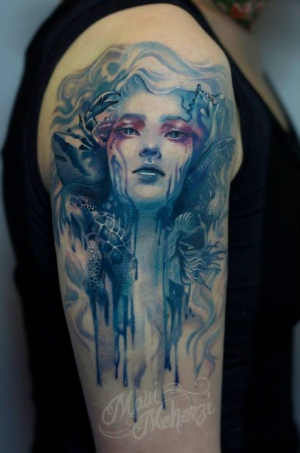 Old school illustrative style colored shoulder tattoo of fantasy woman with crab