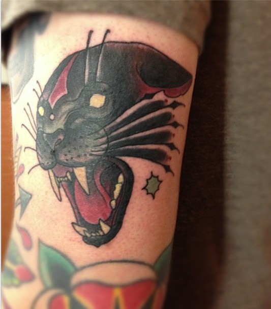 Old school style colored arm tattoo of roaring black panther with stars