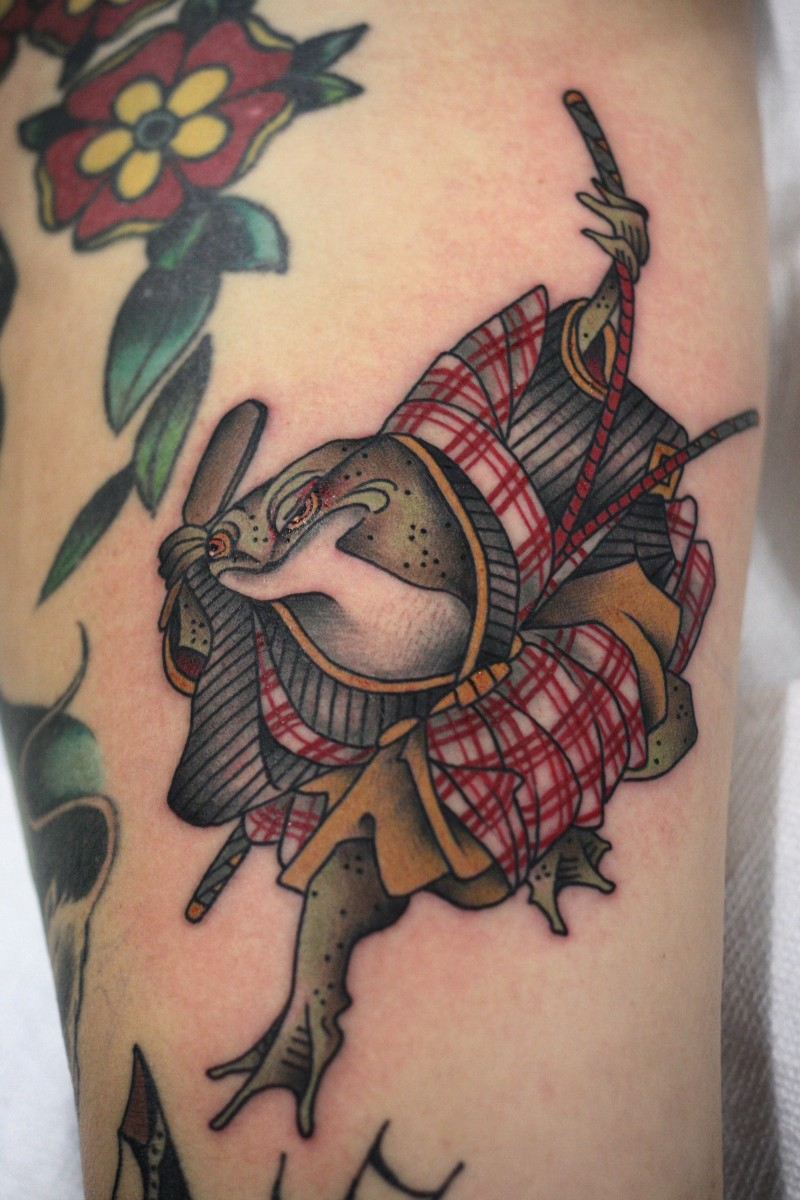 Old school style colored arm tattoo of fantasy warrior frog