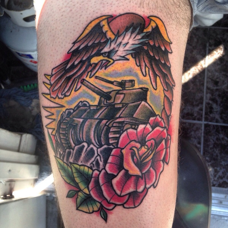 Old school style colored arm tattoo of Sherman tank with rose and eagle
