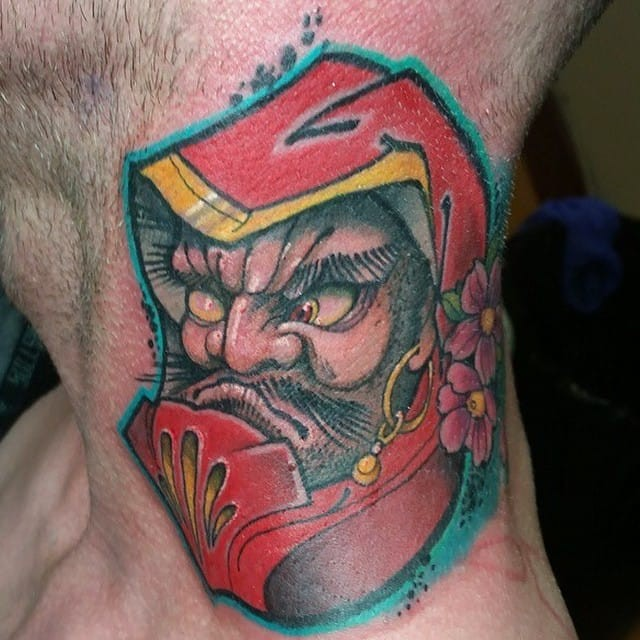 Old school style colored neck tattoo of angry daruma doll