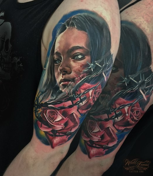 Old school style colored shoulder tattoo of demonic woman with roses and barbed wire