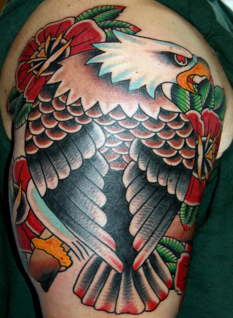 Old school style colored shoulder tattoo of typical eagle with flowers