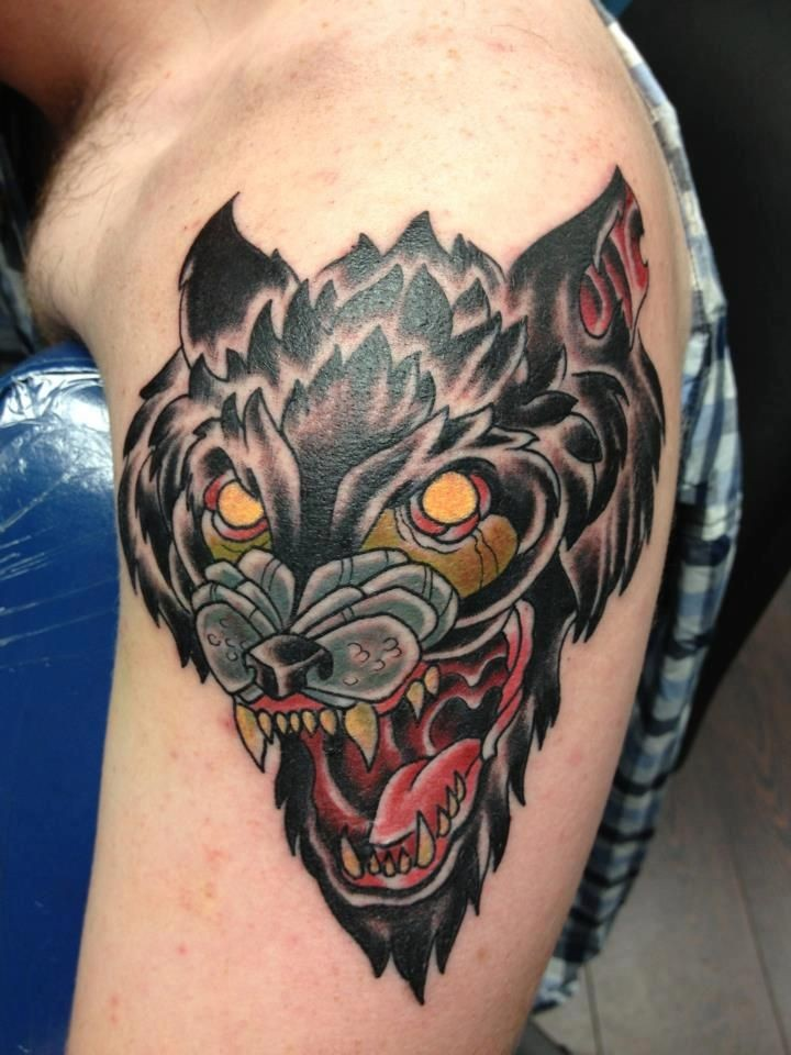 Old school style colored shoulder tattoo of evil dog head