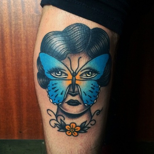 Old school style colored tattoo of woman with butterfly mask