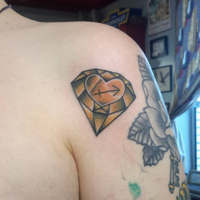 Old school yellow diamond with heart and Sagittarius symbol colored shoulder tattoo