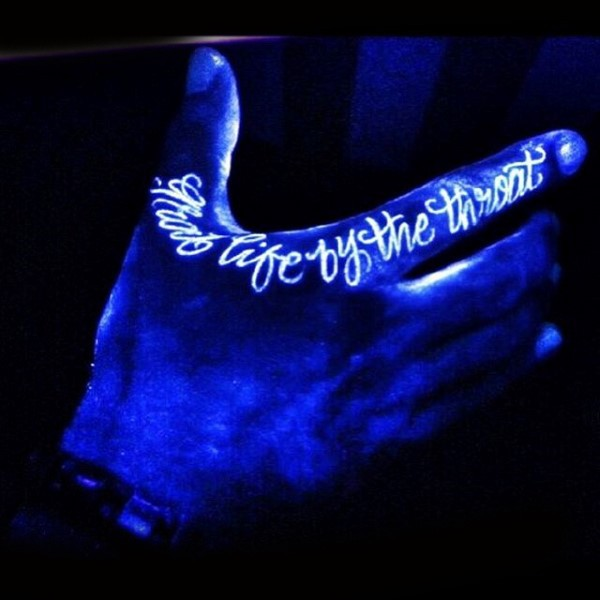 Original lettering white ink luminescence tattoo on fingers