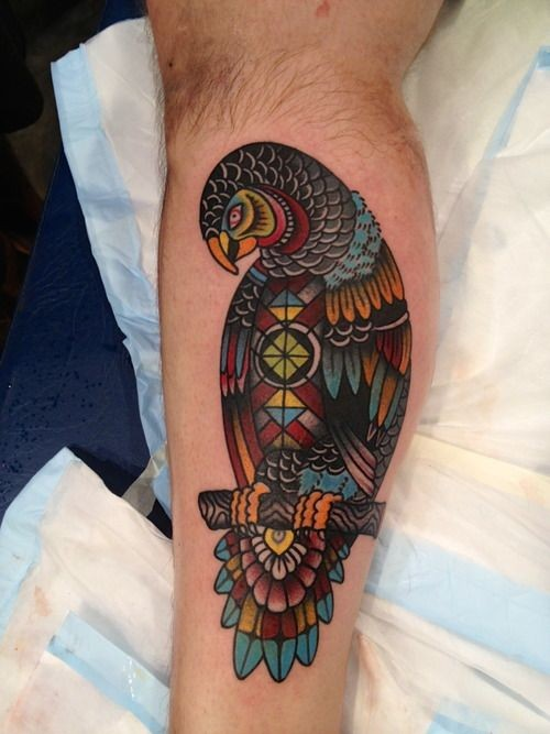 Patchwork parrot tattoo on arm