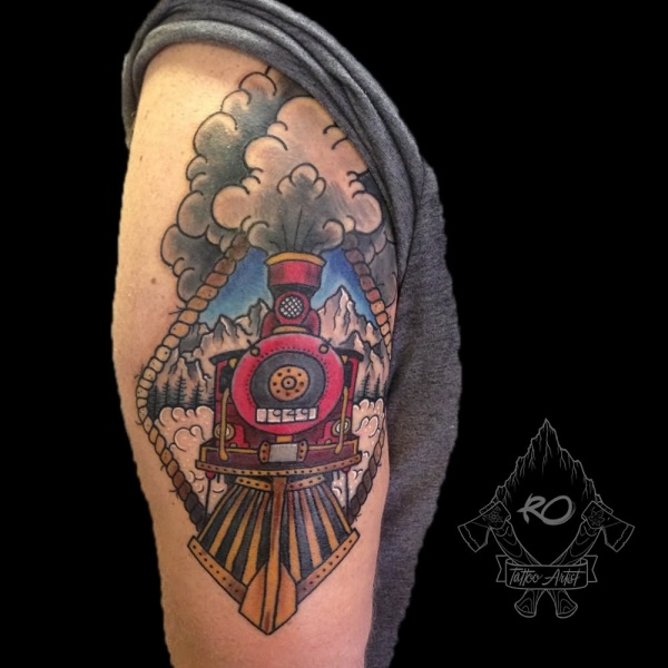Portrait like old school style colored upper arm tattoo of steam train and mountains