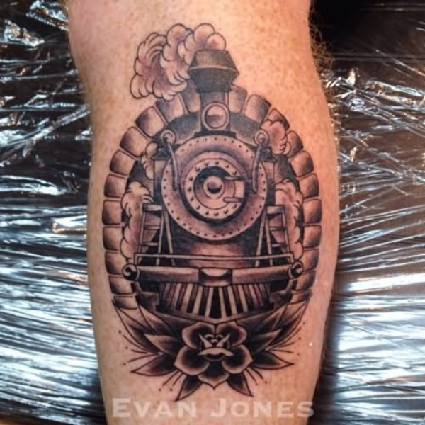 Portrait style black and gray keg tattoo of train with flower