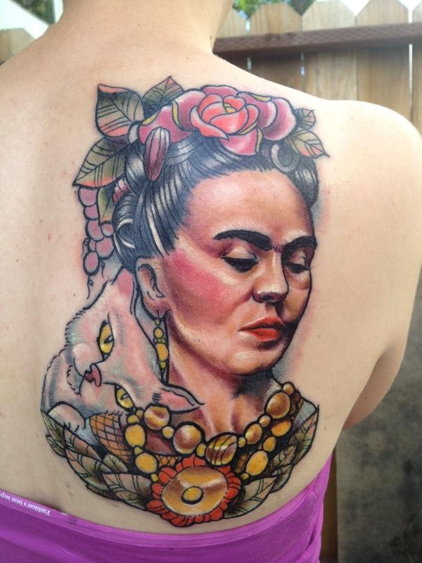 Portrait style colored scapular tattoo of old woman with cat and flowers