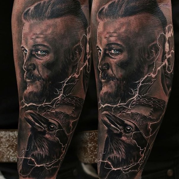 Portrait style colored shoulder tattoo of Viking with crow