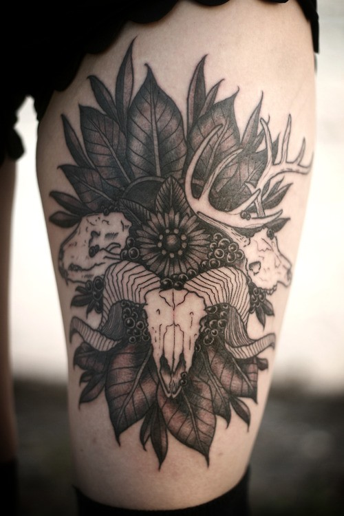 Ram tattoo in leaves with flowers