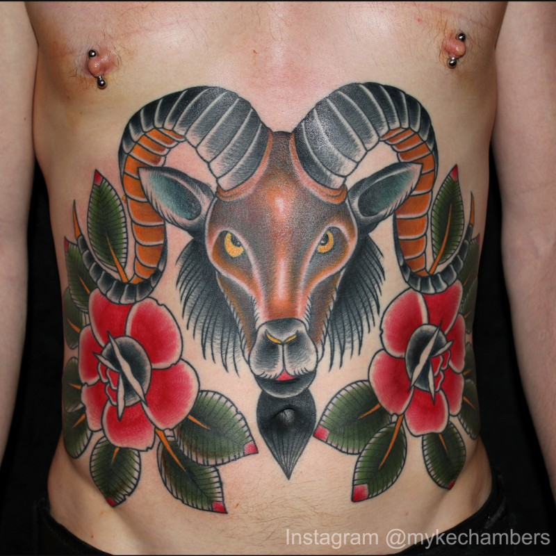 Ram tattoo with red flowers