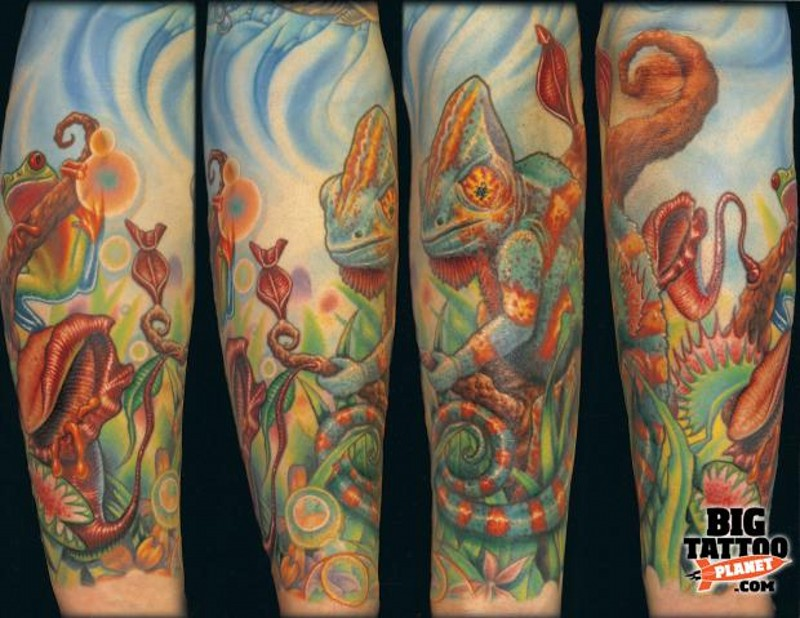 Real life looking colorful chameleon tattoo on arm with jungle plants