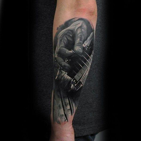 Real photo like black and white music themed musician with guitar tattoo on arm