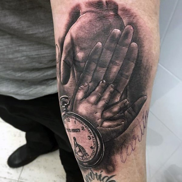 Real photo like black and white old clock with family hands tattoo on arm